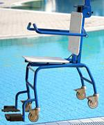 chair for disabled people to make use of the pool for the handicapped - stock photo