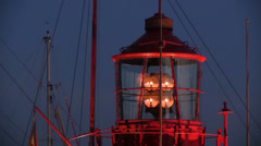 Rotating lighthouse at dusk in harbor in Hamburg Stock Footage