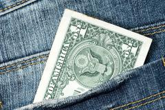 Stock Photo of one dollar note in the jeans pocket