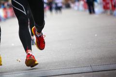 Marathon runner on finish line - legs closeup. Stock Photos