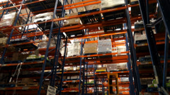 Logistics warehouse shelving and forklift - stock footage