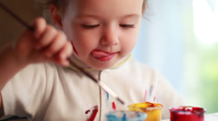 Cute baby paint with gouache. Stock Footage