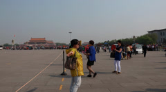 Tourists taking photos in tiananmen square china Stock Footage