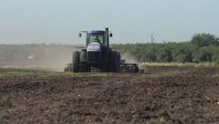 Tilt up from Field to Tractor Stock Footage