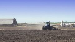 Tractor Discing Field on Farm with Blue Sky Stock Footage