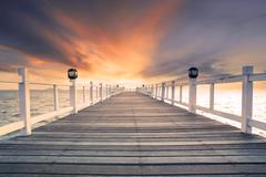 old wood bridg pier with nobody against beautiful dusky sky use for natural b - stock photo