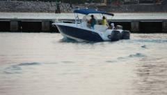 Speed boat passes harbor wall at Miami Beach Marina - stock footage