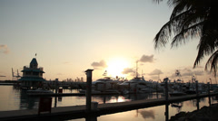Sunset through boat masts and flying bridges at the marina Stock Footage