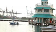 Miami Beach Marina with control tower and harbor cranes - speed boat crosses Stock Footage