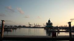 Sundown at Miami Beach Marina with cranes of the harbor behind Stock Footage