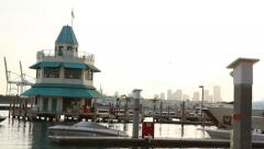 Speed boat moored in front of Miami beach Marina control tower Stock Footage