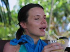 Happy woman drinking cocktail in exotic place, steadycam shot Stock Footage