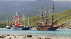 Styled ancient pirates and vikings sailing ships in bay of Phaselis city Turkey Stock Footage