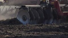 Dramatic Slow Motion of Tractor Discing Field 04 Stock Footage
