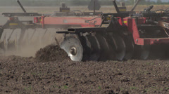 Dramatic Slow Motion of Tractor Discing Field 06 Stock Footage