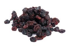 Dark raisin on white background - stock photo
