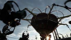 Amusement park ride view against the sun Stock Footage