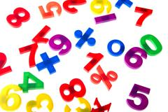 plastic numbers on white - stock photo