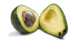 Cutting avocado close up - stock photo