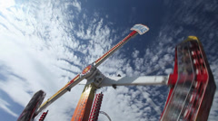 Amusement park ride during the day Stock Footage