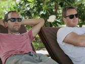Stock Video Footage of Men chilling on sunbeds, steadycam shot