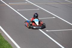 young go-carting  racer finish - stock photo