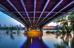 View from the steel bridge to Warsaw at dusk - stock photo