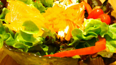 Pouring sauce and eating salad with salmon. Macro video Stock Footage