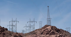 Transmission tower on rocky hills 4k - stock footage