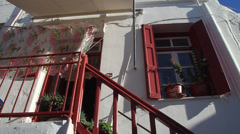 White Mykonos Home with Red Door & Windows Stock Footage