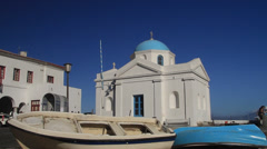 Boats in Front of the Agios Nikolakis Church in Mykonos. Stock Footage