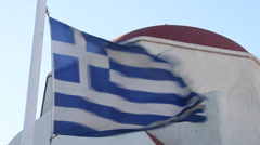Greek Flag in front of Red domed building Stock Footage