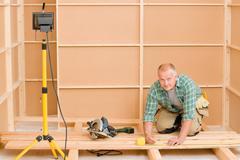 Handyman home improvement wooden floor renovation Stock Photos