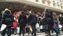 People crossing street at Gallerie Lafayette Paris Stock Footage