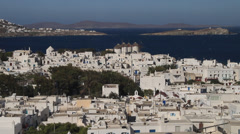 Aerial wide shot of the Mykonos skyline with windmills in the distance. Stock Footage