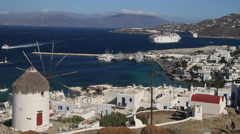 Wide shot of the port of Mykonos with windmill and cruise ship. Stock Footage