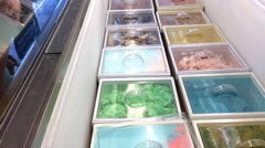 Various selections of ice cream behind glass Stock Footage