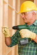 Handyman home improvement working with screwdriver Stock Photos