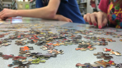 Kids building puzzle in library Stock Footage