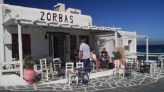 People eating on patio of Zorbas Restaurant in Mykonos Stock Footage