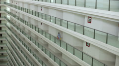 Multiple floors of large hotel building interior Stock Footage