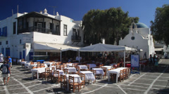 Wide shot of an outdoor Patio in front of the only catholic church in Mykonos Stock Footage