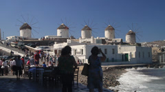 Tourist take pictures of Mykonos windmills Stock Footage