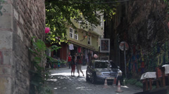 People walk down a laneway in Istanbul Stock Footage