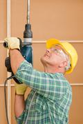 Handyman home improvement working with jackhammer Stock Photos