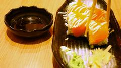 Eating rolls with salmon Philadelphia Maki Sushi. Macro video Stock Footage