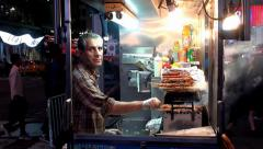 Halal food cart on Times Square of NYC at night. New York, USA. Stock Footage