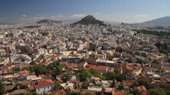 Aerial view of Athens with Mount Lycabettus in the distance Stock Footage