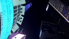 Bottom view of Times Square Skyscrapers at night Stock Footage