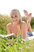 young womn reading a book - stock photo
